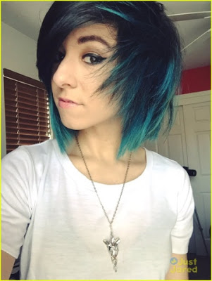 Christina Grimmie in an all too familiar 'all seeing eye' pose ala blue hair and the elven Evenstar necklace from Lord of the Rings, a symbol of immortality.
