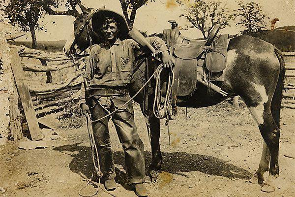 "An unknown cowboy, who, judging by his saddle, side arm and rifle was riding the trails circa 1870 or 1880. On the back of this early photograph is simply inscribed ""Indian fighter."""