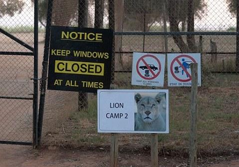 Signs at the entrance of the lion park